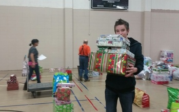 Volunteers help sort and deliver holiday gifts for the Salvation Army in Gary, Indiana. (Veronica Carter)