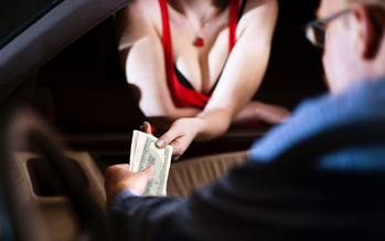 People who get caught paying for sex in North Dakota could soon end up in john school. (iStockphoto)