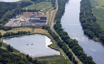 Dominion Energy's plans to close huge coal-ash impoundments, like this one at the Bremo Power Station on the James River, are drawing criticism. (Nick Kotula)