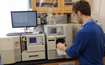 A Student tests a water sample from a New York lake to identify the presence of cyanobacteria toxins. (SUNY College of Environmental Science and Forestry)