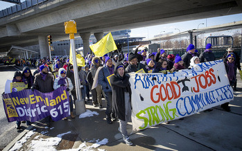 Logan Airport workers rally today in support of a bill getting a State House hearing to boost airport workers' pay to $15 an hour. (SEIU)