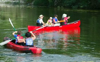 Canoeists enjoy an afternoon at McKinney Falls State Park near Austin. The Texas congressional delegation consistently voted against conservation measures designed to protect such waterways. (Texas Parks and Wildlife) <br /><br /><br />