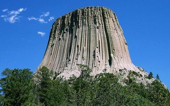 A new report shows counties in Wyoming with more public lands, such as Devils Tower National Monument in Crook County, fare better than counties with less. (Colin Faulkingham/Wikimedia Commons)