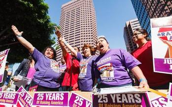 The Justice for Janitors movement protested last month in Los Angeles. It holds rallies across the state today (Tues.) for International Women's Day. (Ian Paredes/SEIU)
