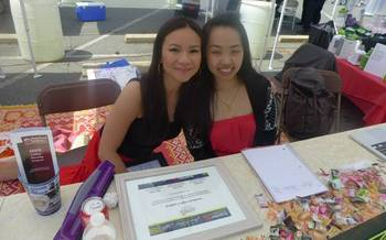 Cat Bao Le, left, is pictured with another member of the Southeast Asian Coalition as they conducted outreach at the Annual Dragon Boat Festival in Charlotte. (Le)