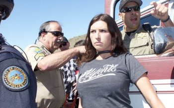 Jacinta Gonzalez (center) was arrested on Saturday near Phoenix for blocking traffic on a road leading to a political rally for presidential candidate Donald Trump. (Mijente)