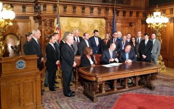 Gov. Tom Wolf signs executive orders banning discrimination against LGBT people. (Equality Pennsylvania)
