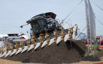 A GPS-guided combine is one of the systems potentially vulnerable to cyber attacks. (Scoty/Wikimedia Commons)
