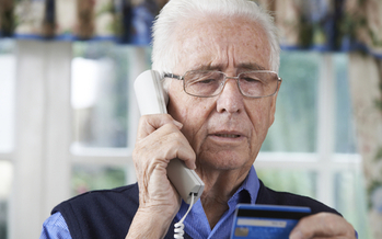 Wisconsin is getting hit with a rash of calls from scammers posing as IRS agents, demanding payment for nonexistent back taxes. (Highwaystarz Photography/iStockphoto)<br />