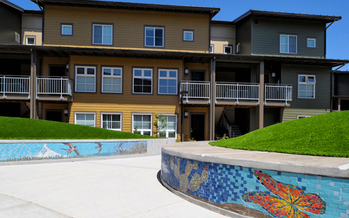 Farmworker Housing Development Corp. builds housing, such as the building above, for farmworkers and their families. (FHDC)