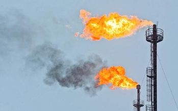 Flares burn off excess gas at an oil production facility. On Tuesday California proposed new inspections to prevent leaks. (Environmental Defense Fund)