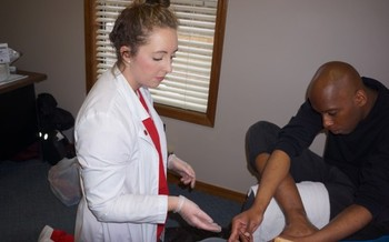 Nursing students teach proper foot care to patients in homeless shelters in Fayetteville. (Eleanor Mann School of Nursing)