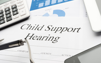Thousands of North Dakota parents who are behind in child support payments are getting some unique help to catch up. (iStockphoto)