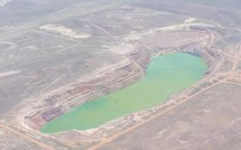 A new study finds the lake in the pit of the former Lone Tree Mine near Battle Mountain is leaching water from the nearby Humboldt River, reducing flow. (Tom Myers)