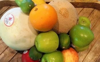 Shopping for fresh fruits and vegetables through Farmacy, an innovative healthy eating program. (Greg Stotelmyer)