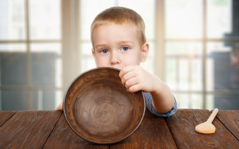 Advocacy groups are pushing political candidates to focus on child poverty. (Milkos/iStockphoto)