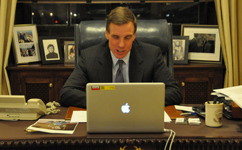 Sen. Mark Warner, D-Va., co-founder of the cyber-crime caucus and seen here using Skype, says the DNC hack could have profoundly disturbing implications. (Warner's Office)