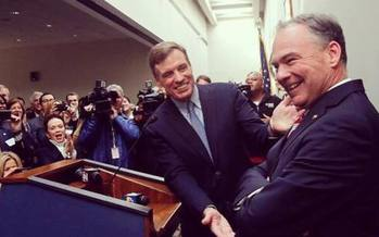 Sen. Mark Warner, D-Va., co-founder of the cyber-crime caucus and seen here shaking the hand of vice presidential nominee Tim Kaine, says the Democratic National Committee hack could have profoundly disturbing implications. (Warner's Office)