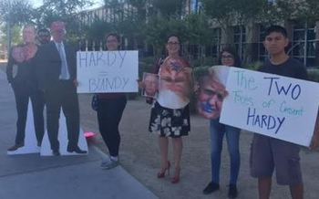 Protesters from Next Gen Climate equate Rep. Cresent Hardy, R-Nev., with Donald Trump and Cliven Bundy outside a hearing on public-lands management in North Las Vegas on Tuesday. (Next Gen Climate)