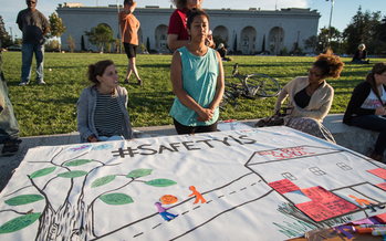 Attendees show their support at the Night Out For Safety and Liberation in Oakland, Calif., in 2015, a rival event to the National Night Out. (Brooke Anderson)