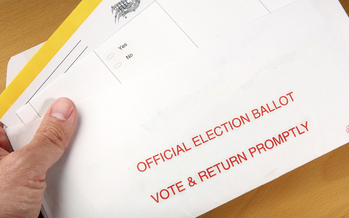 California may go to a vote-by-mail system and eliminate local polling places. (svanblar/iStockphoto)