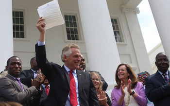 As Gov. Terry McAuliffe signs orders restoring voting rights to reformed Virginia felons, many are questioning the law making that necessary. (Michaele White/Governor's Office/Flickr)