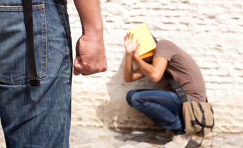 Heading back to school means being bullied for 25 percent of teens in the United States. (iStockphoto/Helder Almeida)