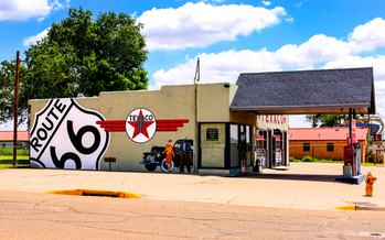 A remodeled Texaco gas station, originally built in the 1950s, sits along the original Route 66 through Tucumcari, New Mexico. (csphoto/iStockphoto)<br />