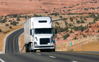 The Obama administration has announced new standards for large trucks and buses, expected to cut emissions by 25 percent over the next decade. (Sadura/iStockphoto)
