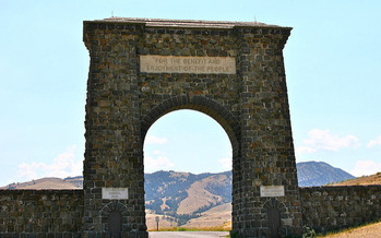 The centennial celebration of the National Park Service is being held in front of the Roosevelt Arch, above. (Chuck Grimmett/flickr)