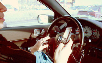 In 2014, more than 3,100 people were killed and 431,000 injured by distracted drivers. (Ed Poor/Wikimedia Commons)