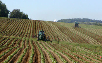 Maine farmers were busy this weekend, with a tractor parade in Augusta to help fight hunger. Maine has the most farms in New England, but is also tops in food insecurity. (NightThree/Wikimedia Commons)