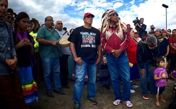 Chairman Archambault (left) and Chief Arvol Looking Horse are involved in the latest fight against the Dakota Access Pipeline that also spotlights decades of racial discrimination against Native populations in North Dakota. (Photo by Jenni Monet)