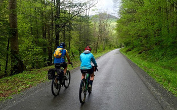Tourists bike on the Williams River Road after flood damage repairs. Supporters of a new Birthplace of Rivers National Monument say it should help the area recover from this summer's storms. (Matt Kearns)