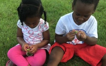 Letting children touch, feel and taste locally grown foods is part of National Farm to School Month observations in October. (Institute for Agriculture and Trade Policy)
