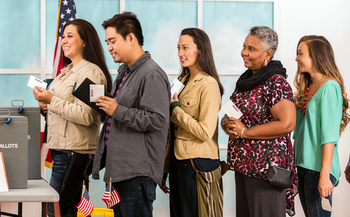 A study finds African-American voters and Latino voters waited, on average, up to twice as long at the polls as white voters in the last election. (PMoore/iStockphoto)