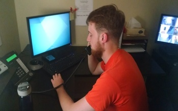 Suicide Prevention Hotline employee Joshua Drummond is among those provided free 24/7 help to Granite Staters in crisis. (Headrest)