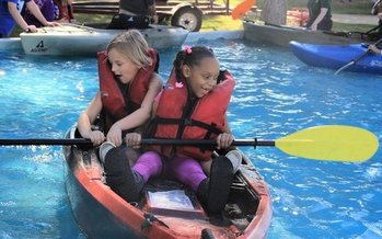 Kids learn to kayak at the
