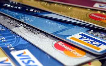 Prepaid debit cards can come with hidden fees, but that could soon change. (Frankeleon/Flickr)
