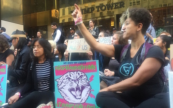 Women formed a human wall outside Trump Tower on Fifth Avenue. Similar protests were held in more than a dozen other U.S. cities. (Brigid Flaherty)