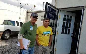 Sierra Club volunteers Tom Gorman and Michael Melendrez canvas the neighborhood encouraging residents to vote. (Susan Martin/Sierra Club Rio Grande Chapter)