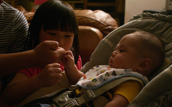 Sometimes a fist bump can suffice for children to show affection toward family members, says Taryn Yates of the Idaho Children's Trust Fund. (mliu92/Flickr)