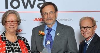 Don Corrigan of Des Moines, center, is the 2016 AARP Iowa Andrus Award Winner. (AARP)