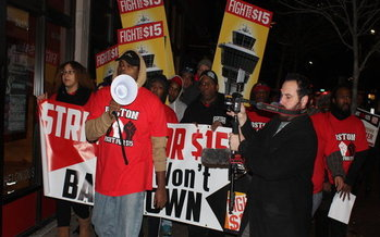 Hundreds of low-wage workers were out before dawn in Boston, marking the fourth anniversary of the
