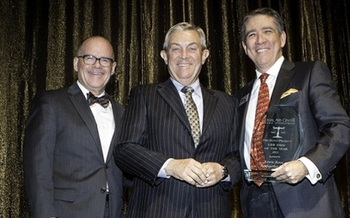 Dan Waite (L) and Dan Polsenberg (R) accept the 2015 Pro Bono Award from Justice James Hardesty for Law Firm of the Year. (Legal Aid Center of Southern Nevada)