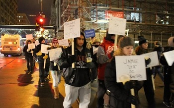 Marchers carry signs with the names of those who have died homeless in Minneapolis. (Minnesota Coalition for the Homeless)
