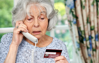 AARP Texas warns that the holidays are prime time for scam artists to target seniors for fraud and abuse. (highwaystarz/iStockphoto)