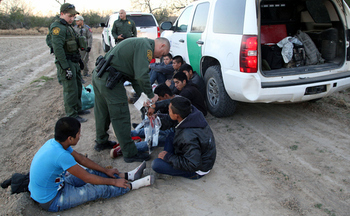 Border Patrol agents detain a group of unaccompanied Central American children shortly after they crossed the border into the United States. (vichinterland/iStockphoto)