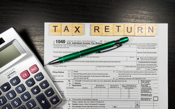 Government agencies and private companies are taking steps to combat tax identity theft. (DaLiu/iStockphoto)