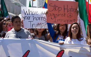 Hispanics and others protest President Trump's immigration policies while waiting for his decision on the DACA program. (shakzu/iStockphoto)